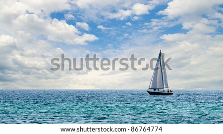 Sailboat on light blue water off Florida Gulf Coast - stock photo