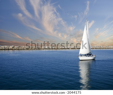 sailboat on peaceful still waters in a harbor - stock photo