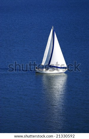Sailboat on the bay - stock photo