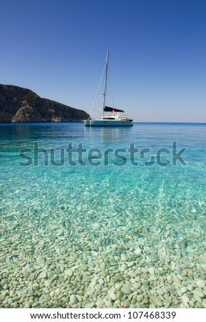 Sailboat on the beautiful beach Porto Katsiki, Greece - stock photo