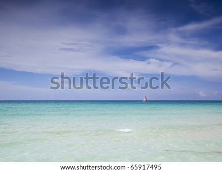 sailboat on the caribbean sea - stock photo