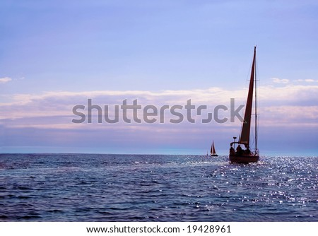 Sailboat on the ocean as the sun sets