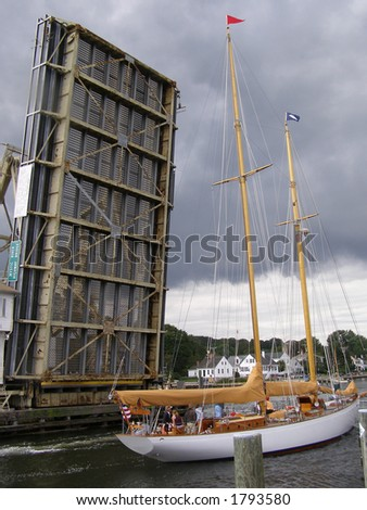 Sailboat passing under drawbridge, Mystic, CT - stock photo