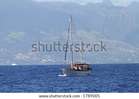 sailboat powered by auxiliary engine, sails down