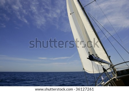 Sailboat sailing blue sea on sunny summer day in Mediterranean