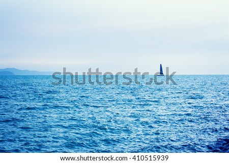 sailboat sailing in sea with color effect - stock photo