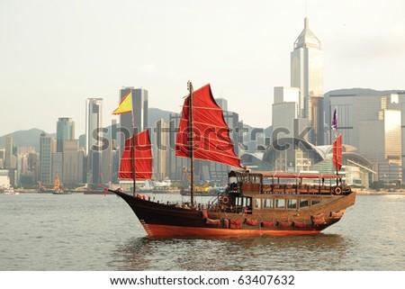 sailboat sailing in the Hong Kong harbor - stock photo