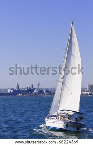 Sailboat sailing in the morning with a clear sky above - stock photo