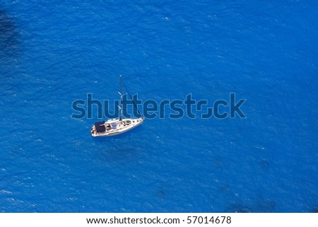 Sailboat sailing the Ionian sea - view from above - stock photo