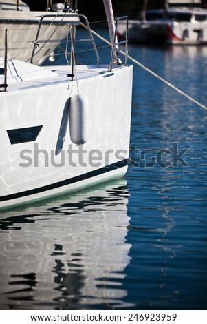 Sailboat Side CloseUp. Vertical shot with reflections - stock photo