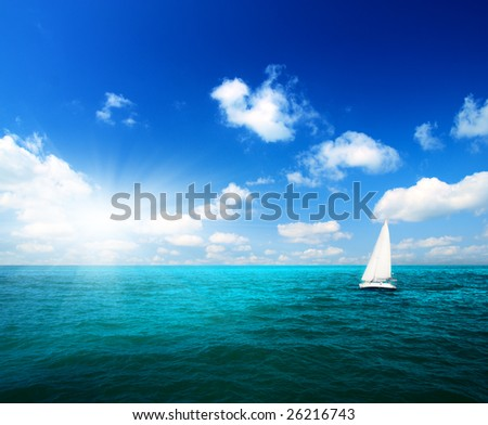 sailboat sky and ocean - stock photo