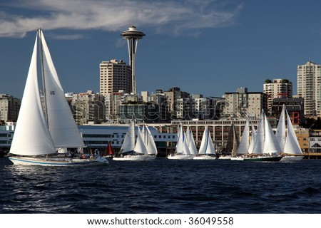 Sailboat sport race in ocean with space needle in Seattle Washington