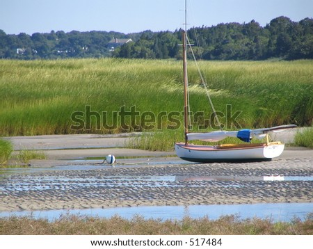 Sailboat stuck in low tide, Cape Cod - stock photo