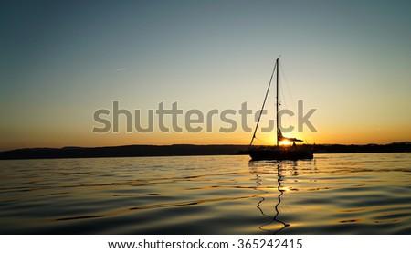 Sailboat Sunset - stock photo