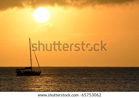 Sailboat Sunset Landscape Over Hawaii Ocean Waters - stock photo