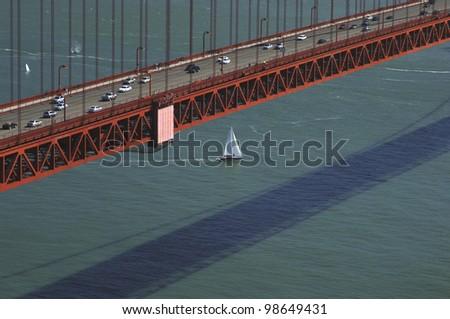 Sailboat under Golden Gate Bridge - stock photo