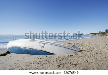 Sailboat washed up on the shores of Santa Barbara - stock photo