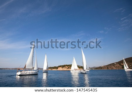 Sailboat. Yachting. Sailing. Travel Concept. Vacation. Regatta on the sea.  - stock photo