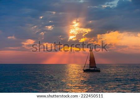 Sailboats against beautiful sunset  - stock photo