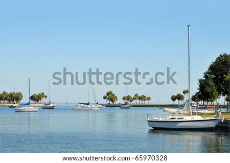 Sailboats anchored in a protective cove. - stock photo