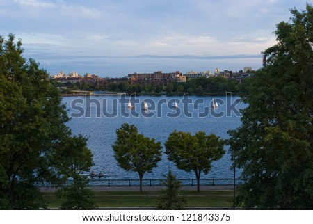 Sailboats and a crew shell on the Charles River - stock photo