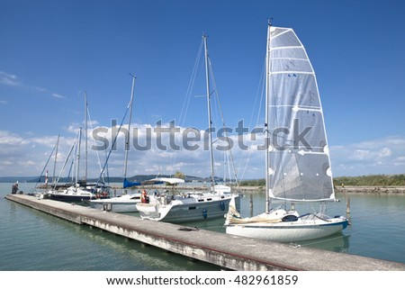 Sailboats and small yachts anchored in Balatonfoldvar at Lake Balaton, Hungary
