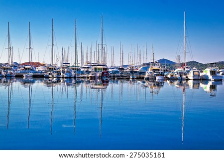 Sailboats and yachts in harbor reflections view, Tribunj, Croatia - stock photo