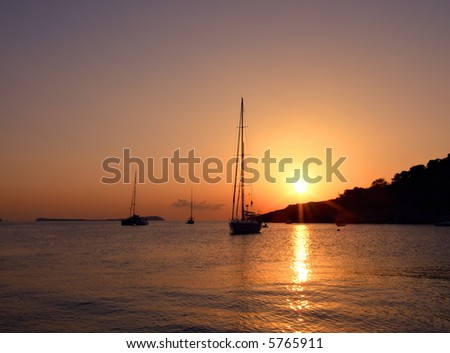 sailboats at Cala Salada, Ibiza, Balearic Islands, Spain, during sunset