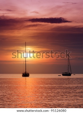Sailboats at dusk. Tropical landscape. - stock photo