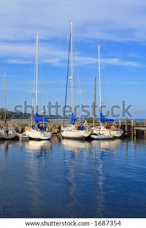 Sailboats at rest on a summer afternoon in Michigan - stock photo