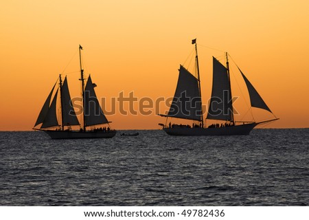 Sailboats at sunset in Key West, Florida - stock photo