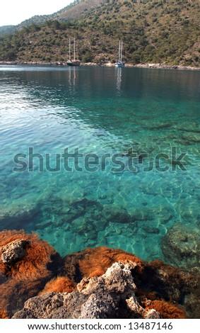 sailboats at the coast of a beautiful bay - stock photo