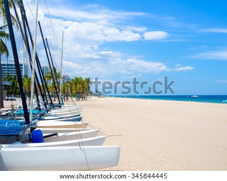 Sailboats for rent at Fort Lauderdale beach in Florida on a beautiful summer day - stock photo