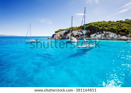 Sailboats in a beautiful bay, Paxos island, Greece - stock photo