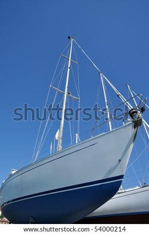 sailboats in a dockyard - stock photo
