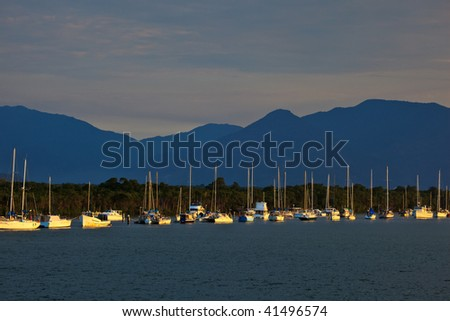 Sailboats in Cairns Harbor at Sunrise - stock photo