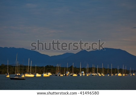 Sailboats Moored in Cairns Harbor - stock photo