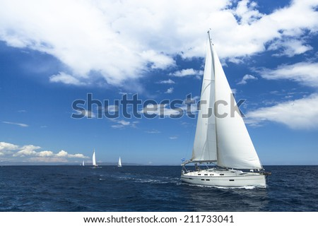 Sailboats participate in sailing regatta. Luxury Yachts. - stock photo