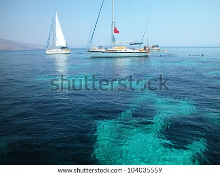 Sailboats surfing Mediterranean sea in Croatia - stock photo