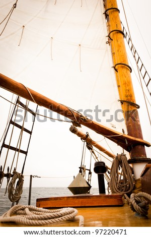 Sailing at sea on a classic wooden schooner - stock photo