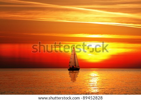 Sailing at sunset - stock photo