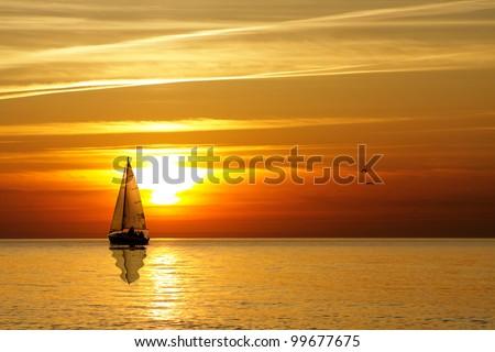 Sailing at sunset - stock photo