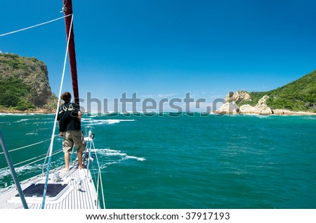 Sailing away through the bay on a beautiful yacht - stock photo