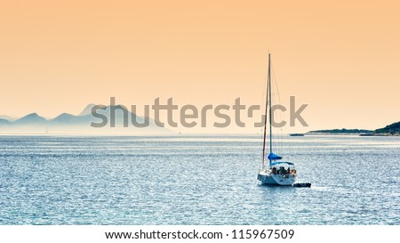 Sailing before sunset - stock photo