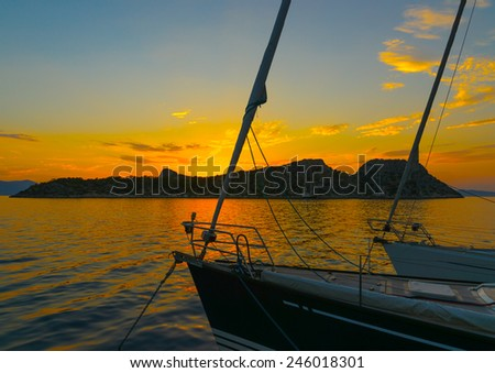 sailing boat anchored in Agkistri island in Greece during sunset - stock photo
