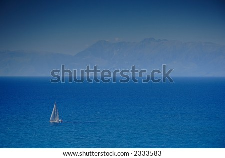 Sailing boat at an open sea, Greece - stock photo