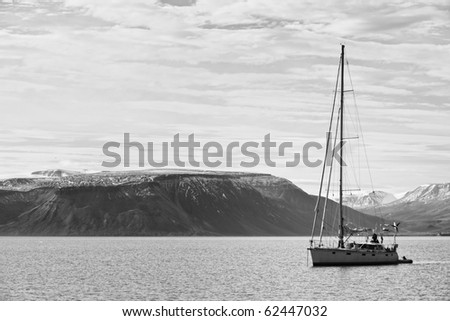 "Sailing boat at anchor in ""Billefjorden"", cloudy, black and white"