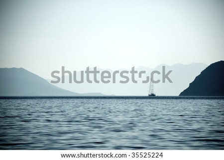 Sailing Boat at Bay - stock photo
