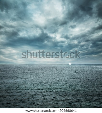 Sailing Boat at Stormy Sea. Dark Background. Loneliness Concept. Toned Photo. Copy Space. - stock photo
