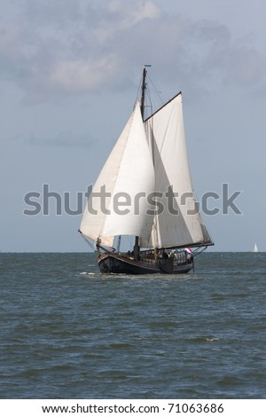 Sailing boat at the Waddensea (the Netherlands) - stock photo